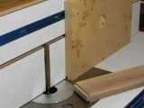 Scrap MDF makes a perfect jig for controll tall narow boards.